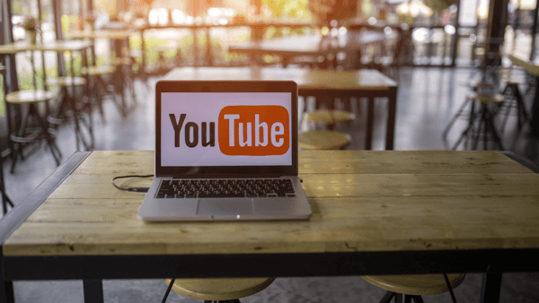 YouTube image on a laptop resting on a restaurant table.
